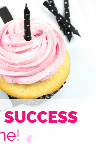 Pink party cupcake with candle and confetti
