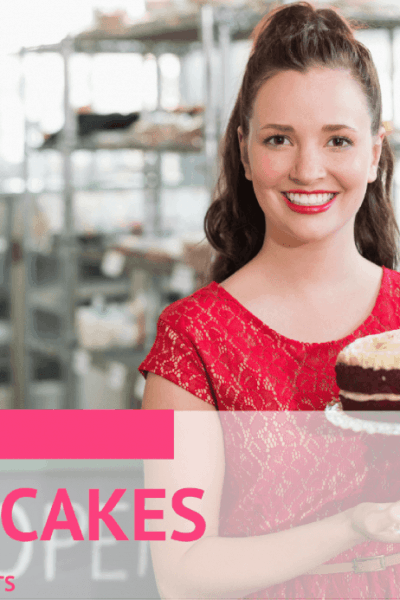 woman holding a red velvet cake on a platter with cake business partner in the background