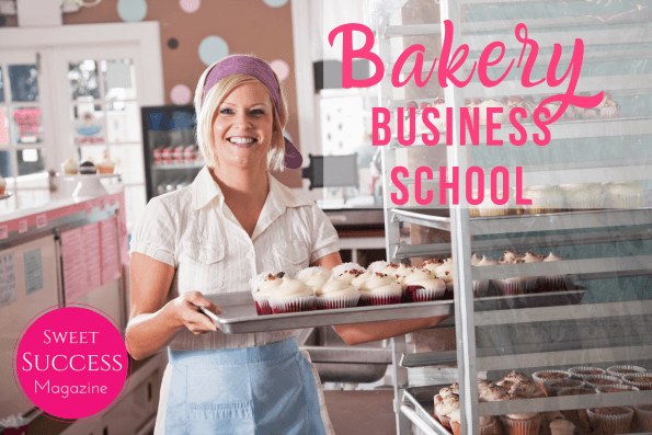 Blonde woman standing in a bakery kitchen holding a tray of red velvet cupcakes, wearing a white dress with a light blue apron and a purple headband