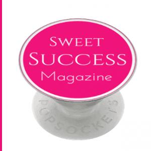 branded popsocket with pink dot logo